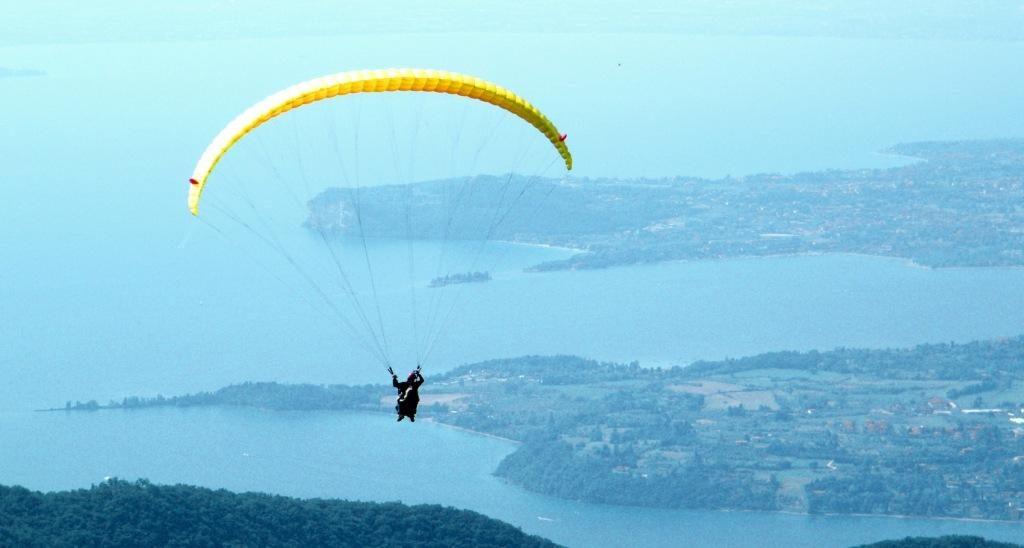 Flying paraglider over Garda lake
