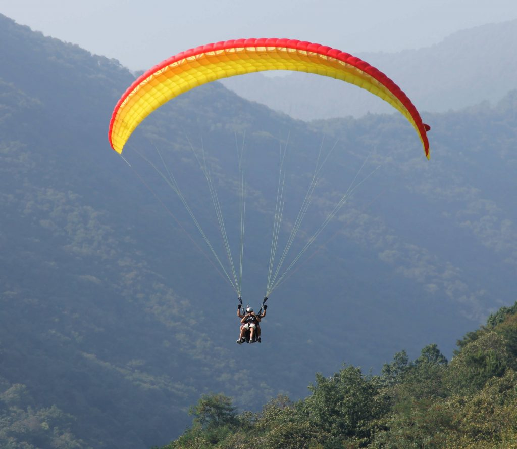 Paraglider landing in Lombardy
